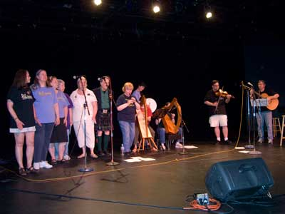Seirm singers and band perform at the Center House Theatre Stage, bringing the power of Gaelic music to Folklife!